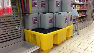 2 drum spill pallet in shop with oil containers on it