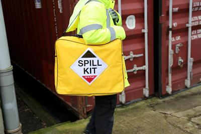 chemical spill kit being carried